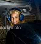 ist2 6279284-female-pilot-and-mature-co-pilot-in-cockpit