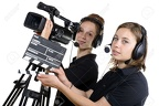 28704786-two-young-women-with-a-video-camera-and-a-clapper-board-Stock-Photo