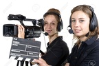 28796635-two-young-women-with-a-video-camera-and-a-clapper-board-Stock-Photo