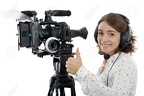 66444654-beautiful-young-woman-with-DSLR-video-camera-and-headphones-Stock-Photo