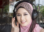 10407380-young-muslim-girl-smile-with-headphones--Stock-Photo