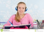 high-school-student-homework-making-desk-music-headphones-46652082
