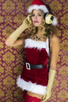 Barbarita Homs in vintage headphones and Christmas outfit