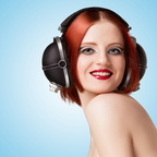 Heavily made up redhead wears vintage Pioneer headphones