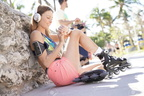 94132055-roller-skater-listening-to-music-with-headphones