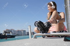 94546237-roller-skater-relaxing-and-listening-to-music-with-headphones