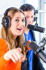 28245768-presenters-or-moderators-man-and-woman-in-radio-station-hosting-show-for-radio-live-in-studio