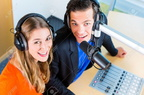 33749066-presenters-or-moderators-man-and-woman-in-radio-station-hosting-show-for-radio-live-in-studio