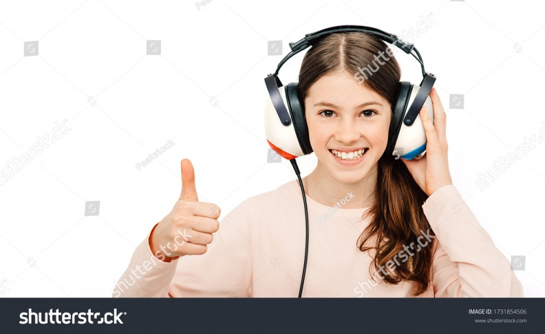stock-photo-hearing-test-positive-girl-in-headphones-during-a-hearing-test-isolated-on-white-audiometry-1731854506.jpg