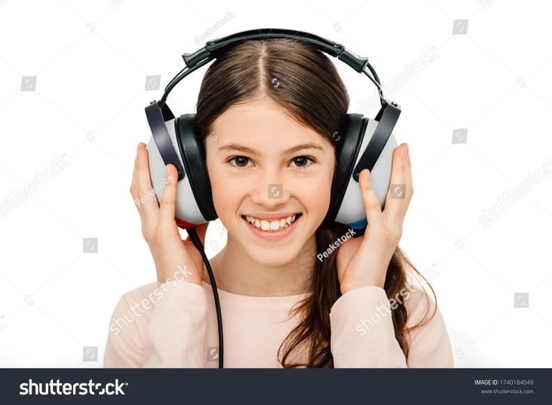 stock-photo-hearing-test-positive-girl-in-headphones-during-a-hearing-test-isolated-on-white-audiometry-1740184049.jpg