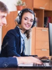 47014405-smiling-employees-of-customer-support-working-in-call-centre