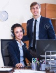 53497258-portrait-of-two-happy-help-line-consultants-at-workplace